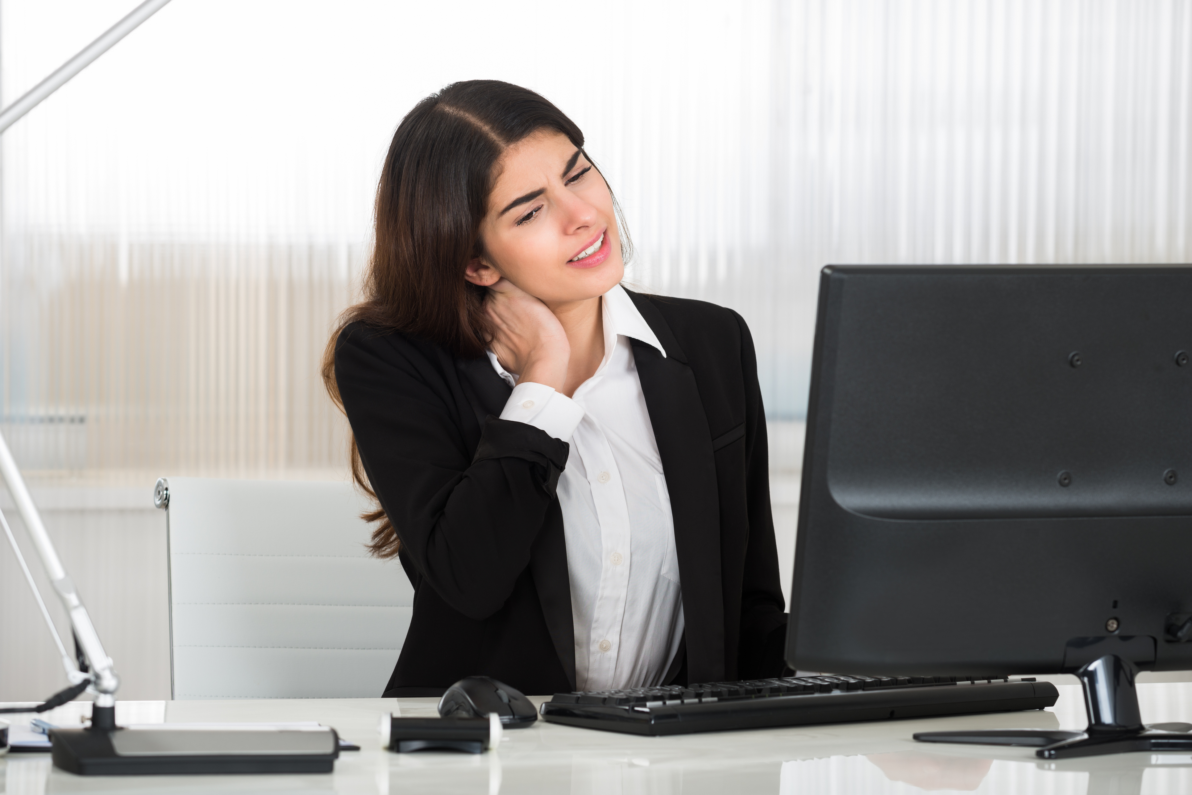Woman with neck pain from computer posture