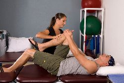Man receiving physical therapy on knee.